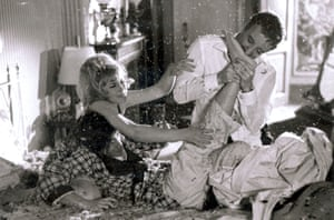 As Cato having his foot bitten in A Shot In The Dark, 1964, with Elke Sommer and Peter Sellers