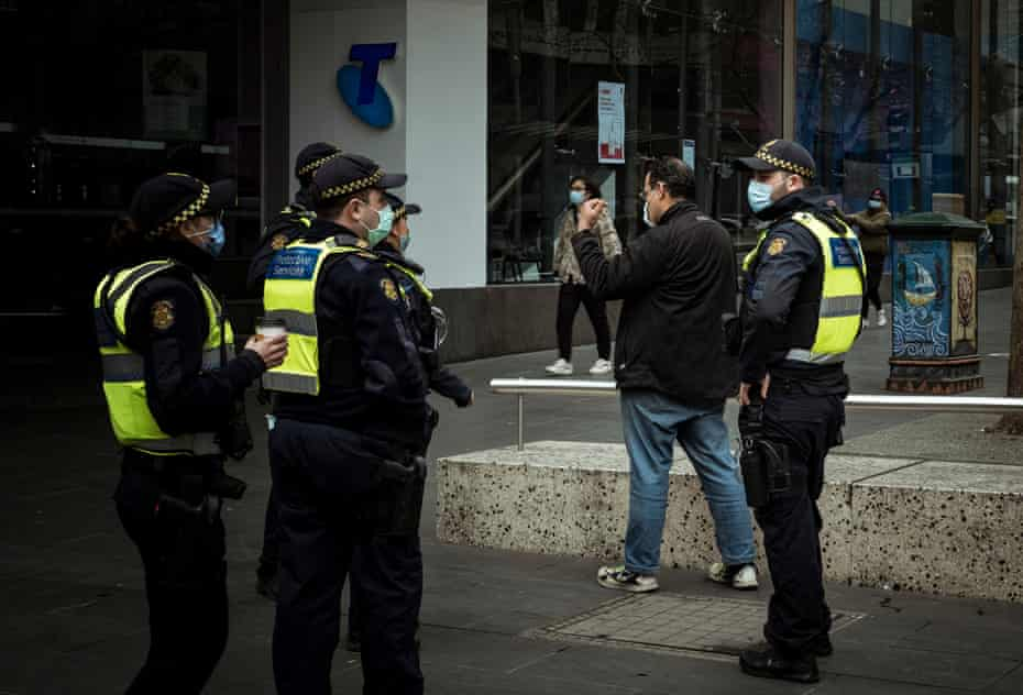 In Bourke Street police are seen enforcing mask wearing protocol.