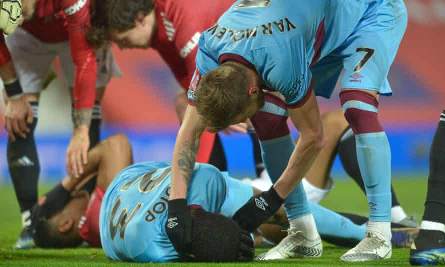 West Ham's Issa Diop lies on the turf at Manchester United after a clash of heads with Anthony Martial.