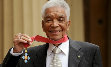 Earl Cameron outside Buckingham Palace with his CBE, which was presented to him by the Prince of Wales in 2009.