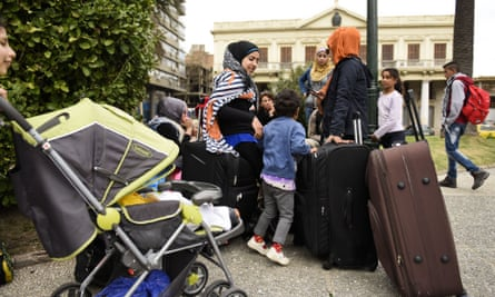 A group of Syrian refugees gather with their belongings in Independence Square in Montevideo, Uruguay, on Monday. The refugees who were welcomed to Uruguay last year are staging a protest demanding authorities allow them leave the South American country.