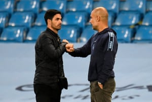 Pep Guardiola and Mikel Arteta pump fists after the final whistle.