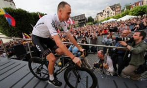 Chris Froome gets on his bike for the presentation of the 104th edition of the Tour de France in Düsseldorf.