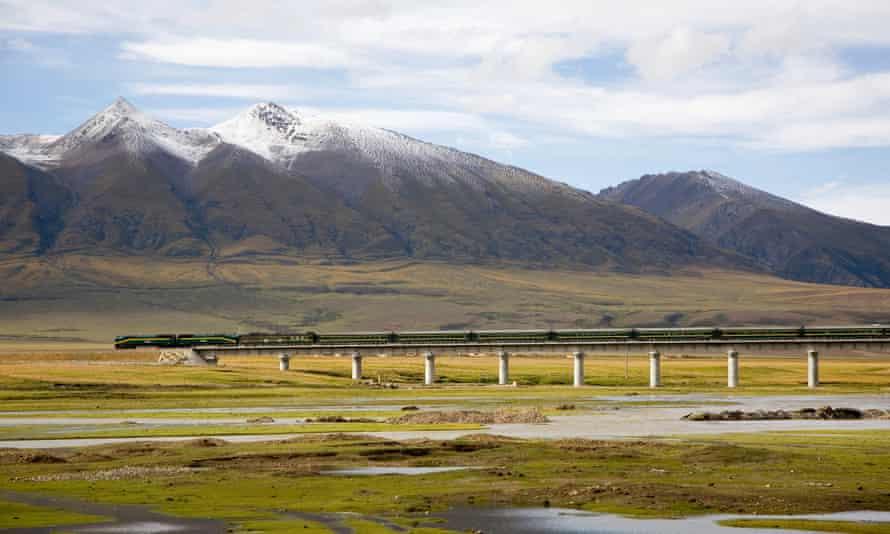 A tibet-china train travels through mountainous countryside