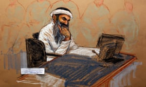 In this photo of a sketch by courtroom artist Janet Hamlin and reviewed by the US Department of Defense, Khalid Sheikh Mohammed reads a document during his military hearing at Guantánamo Bay on 5 May 2012.