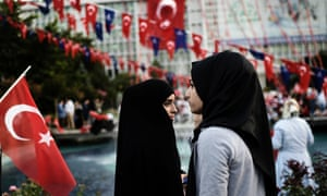 Women wearing headscarves attend a pro-government demonstration last July outside city hall in Istanbul