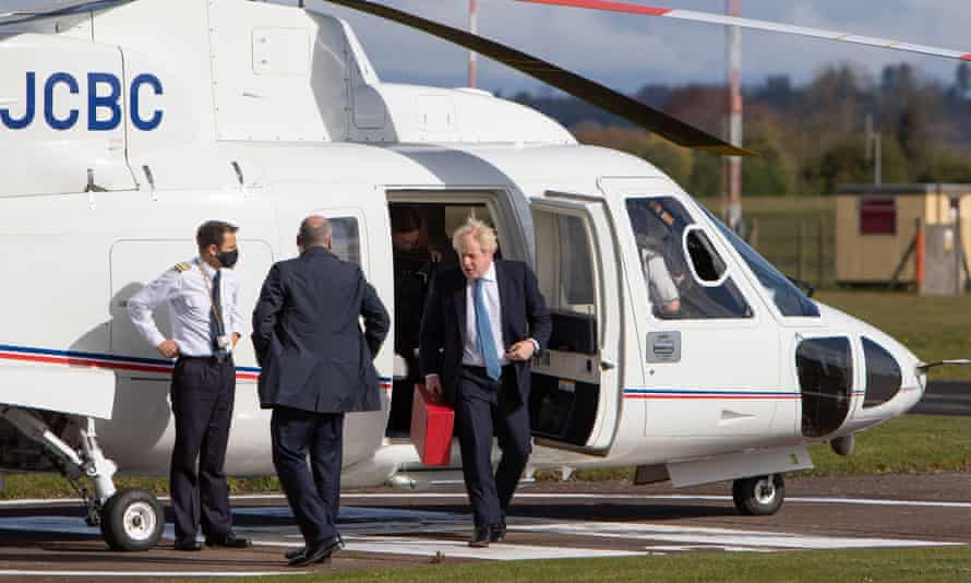 Boris Johnson steps off a helicopter at Wolverhampton Halfpenny Green airport