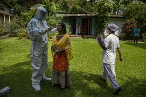 A health worker takes a nasal swab sample to test for Covid-19 during a door to door test drive in Gauhati, India, on Saturday, 29 August, 2020. India has the third-highest coronavirus caseload after the United States and Brazil, and the fourth-highest death toll in the world.