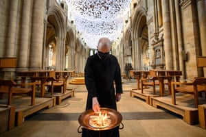 Head verger, Charlie Brown, burns palm crosses from last year's Palm Sunday in the nave of Ripon Cathedral, in Yorkshire, England. The ash will be sprinkled on worshipers as a token of penitence