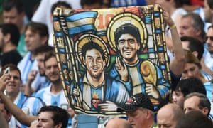 Messi and Maradona share a banner. The sports psychologist Marcelo Roffé says: 'As Argentines, we have done a lot of damage to Maradona ... Let's hope with Messi we learn to modify our behaviour.'