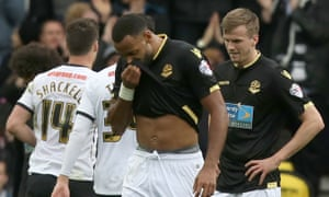 Bolton Wanderers' Liam Trotter and Robert Holding show their dejection as Derby County celebrate