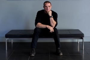 Ian Roberts sitting on a black chair