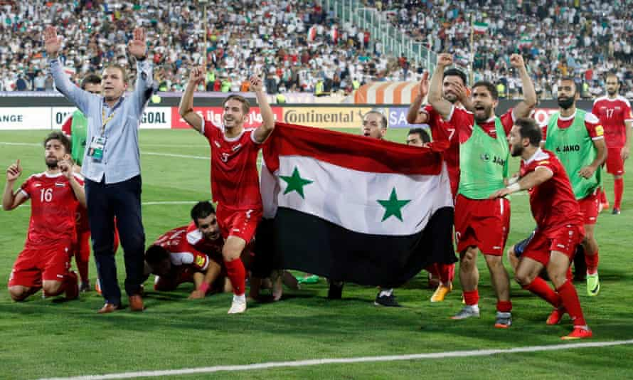 Syria's players celebrate after their draw with Iran.