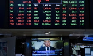 President Donald Trump is displayed on a television screen on the floor of the New York Stock Exchange