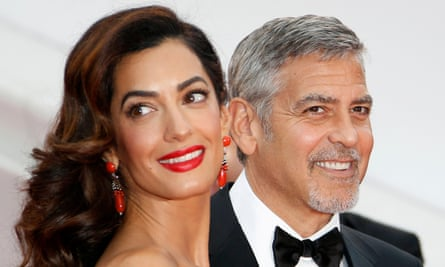 George and Amal Clooney, whose organization has provided financial assistance to combat extremism.