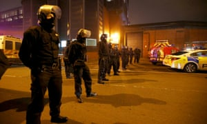 Police officers in riot gear stand outside Winson Green prison