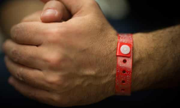 wristband on the arm of an asylum-seeker in Cardiff