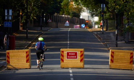 A cyclist rides into a low-traffic neighbourhood in Salford, August 2020.