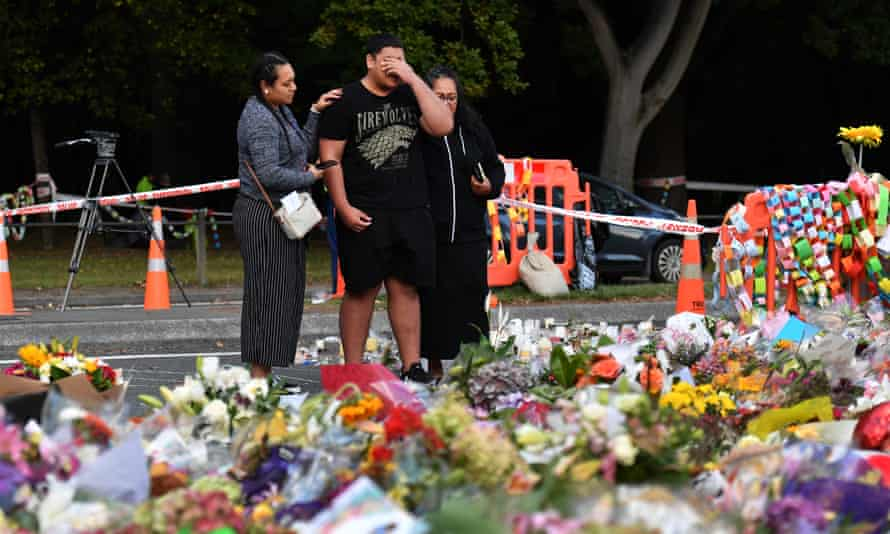 Members of the the public grieve at a makeshift memorial in Christchurch after the massacre in which 51 people were shot dead. Brenton Tarrant, the murderer, used the sonnerad in his manifesto.