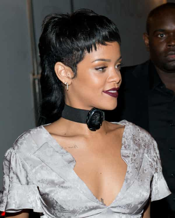 Rihanna in a sliver dress wiht her pair pulled back into a structured mullet style at the back