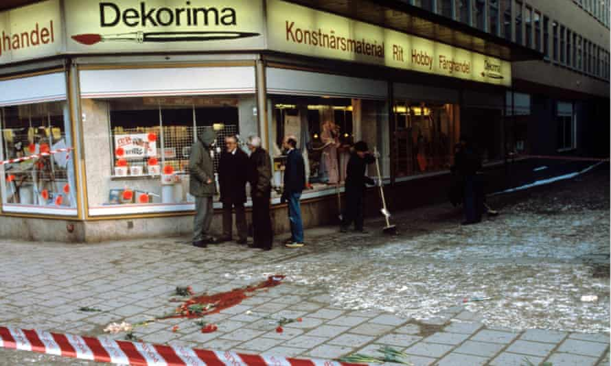 Stockholm street corner, 1986, a large bloodstain is visible on the ground behind police tape