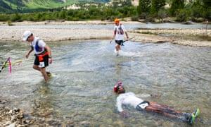 A runner a soak in Lake Creek during the 2014 Leadville Trail 100 ultramarathon in Colorado