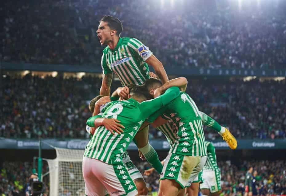 Marc Bartra joins the Real Betis pile-on after Cristian Tello's winning goal against Real Madrid.