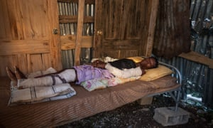 A moving image of a woman in Port Salut, Haiti, injured by hurricane Matthew, which has left nearly 900 people dead and tens of thousands homeless.