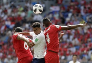 England's Jesse Lingard, centre, catches an elbow in the face.