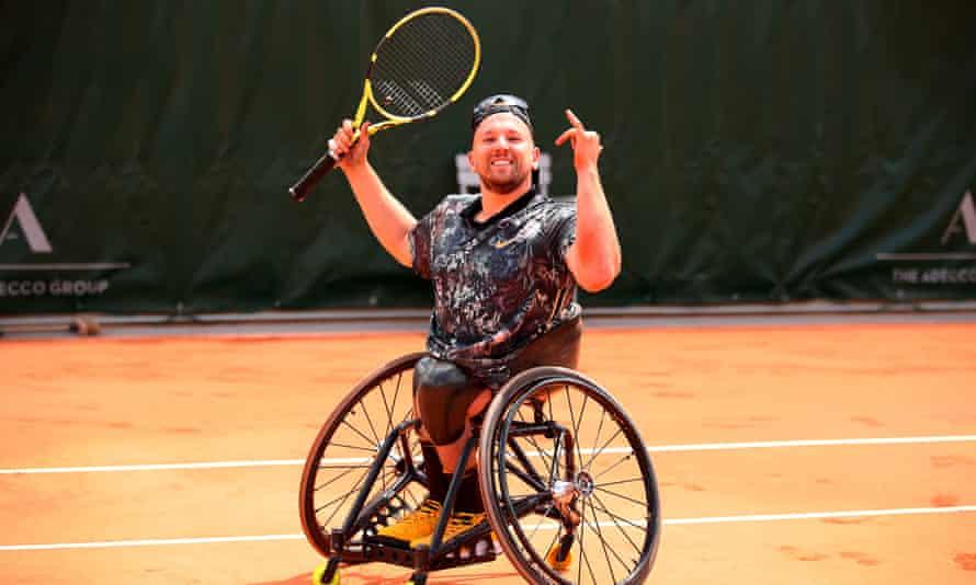 Dylan Alcott celebrates a match point win at Roland Garros.