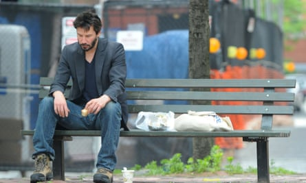 2010 photo of Keanu Reeves on a New York bench that sparked what became known as the Sad Keanu meme.