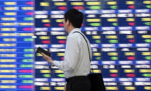 An electric quotation board showing prices on the Tokyo Stock Exchange, where the Nikkei shed 1.7% today