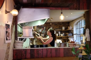 Rachel Roddy keeps an eye on the sausages for the salciccia e friatelli (Neapolitan sausages and greens).