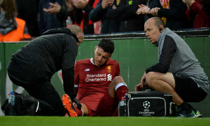 Alex Oxlade-Chamberlain shows his despair after picking up an injury during the Champions League tie betweeen Liverpool and Roma on 24 April.