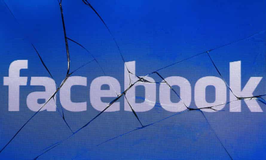 Facebook logo on a cracked phone screen