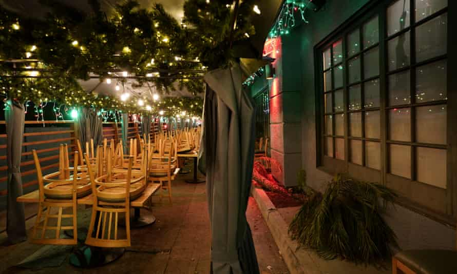 Chairs are stacked on tables in the closed outdoor dining area of a restaurant in Rowland Heights, California, on Monday.