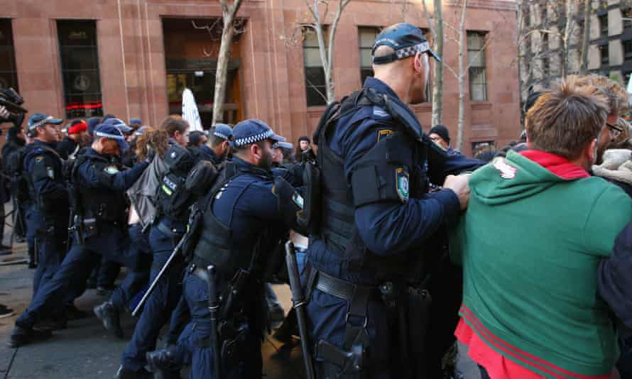 """'Reclaim Australia' Protesters Rally in Sydney<br>SYDNEY, AUSTRALIA - JULY 19: A police line force back the counter protest against the """"Reclaim Australia"""" rally in Martin Place on July 19, 2015 in Sydney, Australia. 'Reclaim Australia' grassroots rallies are being held across Australia to protest the alleged 'Islamisation' of Australia. (Photo by Mark Kolbe/Getty Images)"""