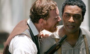 Michael Fassbender as Edwin Epps and Chiwetel Ejiofor as Solomon Northup in 12 Years a Slave.