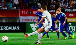 Germany's Babett Peter scores the winning goal from the penalty spot.