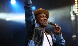 Eddie Amoo of the Real Thing performing on stage at the Wychwood festival in Cheltenham in 2014.