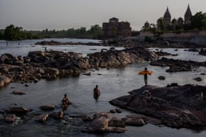 Orchha, India Locals bathe on the banks of the river Betwa