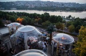 Customers sit inside social distancing domes at the Türkçe Meze restaurant in Istanbul, Turkey.