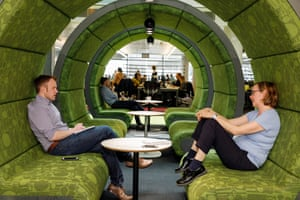 BBC staff chat in a pod at MediaCity in Salford