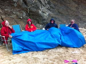 """<strong>Cornwall</strong><br>Top class British beach perseverence on display here.<br>""""Trevone Beach - the only beach on which to be rained on!"""" <br>Photograph: <a href=""""https://witness.theguardian.com/user/sazhewitt11"""">sazhewitt11</a>/GuardianWitness"""