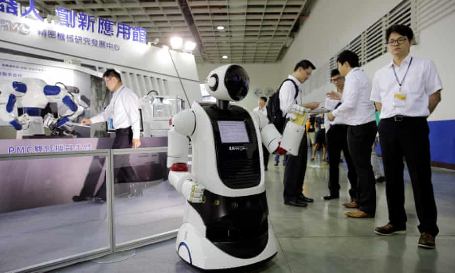 People view a robot during the Taiwan Automation Intelligence and Robot Show in Taipei, Taiwan, in August
