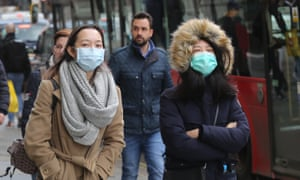 People in London wearing medical masks