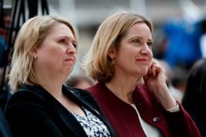 Northern Ireland Secretary Karen Bradley (L) and Britain's Home Secretary Amber Rudd ges