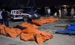 The bodies of drowned migrants are collected in Zuwara, Libya.