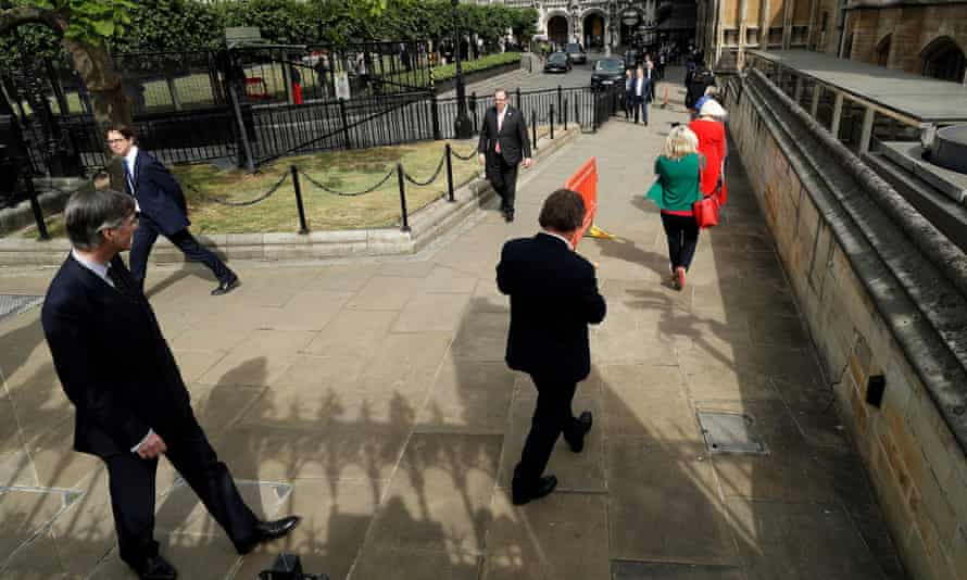 Jacob Rees-Mogg and other MPs queue outside parliament before voting on an end to special coronavirus measures, 2 June 2020