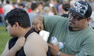 Gabriel San Miguel removes a bandage from his son's back. Abel San Miguel was inside a classroom when the Santa Fe gunman opened fire